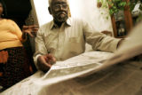 Herman Carr (cq), 77, looks over some newspaper clippings detailing the upcoming release of...