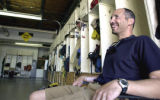Tony Petrilli relaxes in the garage of the Aerial Fire Depot in Missoula on Friday. Petrilli was a...