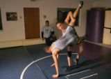 Richard Apodaca (cq) 17, right, flips teammate Jonathan Candelaria (cq), 16, left, during practice...