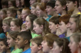 Colorado Children's Chorale perform for over 2,000 Denver metro school children who filled the...