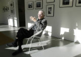 Denver, CO Jan. 13, 2006 James Milmoe sits in front of his photographs on display at Gallery Sink...