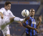 Denver, Colo., PHOTO TAKEN MAY 7, 2004- new England Revolution player, Jay Heaps (left in white),...