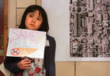 "Amber Tanaka (cq), 9, a 4th-grader at Bromwell holds a sign that says ""Save the Plaza""..."