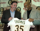 OAS101 - Frank Thomas, right, smiles as he accepts his new jersey from Oakland Athletics general...