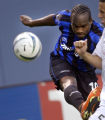 Denver, Colo., PHOTO TAKEN MAY 7, 2004- Colorado Rapids player, Jean Philippe Peguero (left),...
