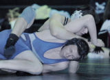 Gilchrest, CO Jan. 25, 2005 Curtis Salazar of Valley trys to pin Adam Symonds of Platte Valley...