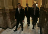 Colorado Governor Bill Owens makes his way to the House chambers in the Colorado State Capitol to...
