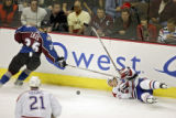 The Colorado Avalanche's John-Michael Liles (#26) looks back for the puck as the Montreal...