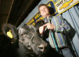 (Denver, Colo., January 20, 2006) Stetson Copus and his grand champion steer.  The 2005 Auction of...
