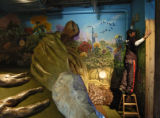 John Farrales (cq) washes smoke of the walls of the Ant Colony display of Children's Museum...