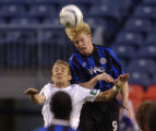 Denver, Colo., PHOTO TAKEN MAY 7, 2004- Colorado Rapids player, Nat Borchers (right) and New...