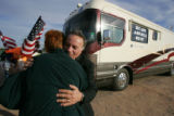 U.S. Congressman Tom Tancredo (R-CO) hugs Sandy Doty, chairperson of the Sun Lakes Republican Club...