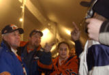 **1/13/06** From left, Die-hard Broncos fans Tom Greenwalt, Roger Johnson, and Angelica Arteaga...