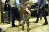 (Thurs. Jan. 12, 2006) Holt Ganzel, 6, of Tulsa, Okla. practices his roping  in the stables at the...