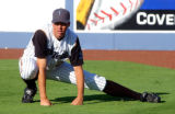 Pitcher for the Tulsa Drillers baseball team Jeff Francis warms up before a game against Arkansas...