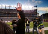 Legendary Denver Bronco quarter back John Elway waves to the Bronco faithful fans as he took the...