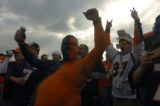 Denver Broncos fan Jeremy Martin, painted in the Broncos colors, whoop it up outside of the...