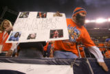 Broncoss fan Justin Miller wears a fake beard and a sign showing Jake Plummer Wannabes before the...