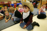 Ryder Gathright, cq, 5, reacts to Jeanann Johnson as she reads a western childrens book to her...