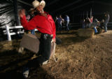 Jamon Turner, cq, 18, practices maneuvers he might use while riding a bull while waiting for...