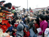 Denver, CO Jan. 29, 2005 Chinese new years celebrants feed dollar bills to one of the dancing...