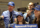 **1/15/06** Members of the Lockheed Martin's Starcraft team celebrate a successful deployment of...