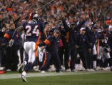 Champ Bailey runs back with the ball after an interception in the 3rd quarter of the Denver...