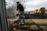 Nikkie Hunt (cq) 18, of Aurora, Colo., places flowers at a memorial at the 17900 Block of East...