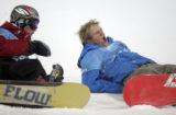 (L-R) Risto Mattila stops to help Chad Otterstrom during practice before the snowboard superpipe...
