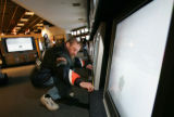 Jack Norwood, cq, 61, of Aurora, examines a 32 inch television at Ultimate Electronics on Colorado...