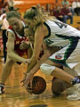 ((((((CORRECT CAPTION)))))))Regis #15 Taylor Johnson, left and #33 Aija Puntina, center, fight for...