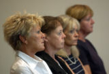 (DENVER, CO., JULY9, 2004) The mother of Erin A. Pendleton, second from left, attends her...