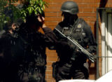 Denver, Colo., photo taken May 9, 2004-Denver S.W.A.T  members get ready to enter an apartment...