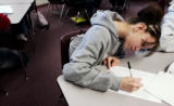 Natalia Flores-Mendrano, cq, solves a math problem during class Monday, Mar. 6, 2006 at Bruce...