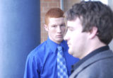 (BACKGROUND) Justin Reed, 18, leaves the Arapahoe County Court building after hearing his verdict...