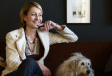 Spotlight.  Home Front-Rooms by local designers. Heather Mourer sits with dog Lucy on the couch at...