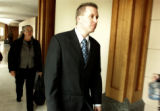 Jospeh Renander, cq, 29, walks out of a Jefferson County courtroom, Wednesday Mar. 22, 2006 during...