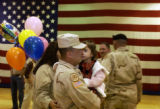 (FOREGROUND LT. TO RT.) Sharon Griego (CQ), of Colorado Springs welcomes home husband Staff Sgt....