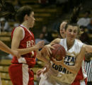 Regis Jesuit High School players Meghan Winters, left, and Taylor Johnson, surround Moffat County...