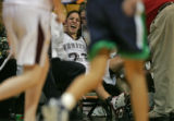 Horizon Hawks starting point guard Nikki Trujillo is side lined with a cramp during the fourth...