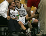 Horizon Hawks starting point guard Nikki Trujillo, left, is held close by teammate Briana...