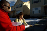 William Duff, left, and Grace Burgwyn plot out their route while canvasing for Coloradans for...