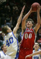 Nate Soldier, right, of Buena Vista, puts up a shot over Brent Schuster, of Denver Christian,...