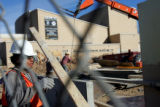 Construction worker Octavio Santiago, cq, works on the expansion of the Lowenstein Theater on...