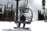 Boarders ride up the triple chair at Echo Mountain Park Thursday March 9, 2006. The new ski...