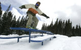 Picnic tables aren't for eating at Echo Mountain Park asJ ustin Kaplan (cq) 18 from Evergreen, CO ...