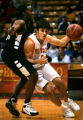 Greeley Central's Tyler McNeese (#1, in white) tries to drive around Harrison's Isiah Harris (#33,...