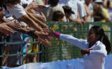 (Sacramento, Calif. on SUNDAY, July 11,2004) -- Fans reach out to women's triple jump winner...