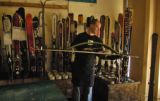 Jack Pallett (cq) gets a ski ready for a Stone Grinder Thursday afternoon March 22, 2006 at Edge...