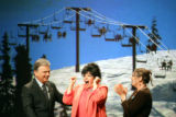 Wheel of Fortune host Pat Sajak (left) congratulates Rose Martin (center) of Aurora after she...